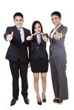 Employees showing thumbs up Royalty Free Stock Photos