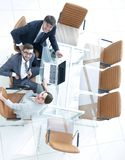 Employees sitting at the desk and looking up. Top view .employees sitting at the desk and looking up Stock Image