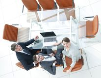 Employees sitting at the desk and looking up. Top view .employees sitting at the desk and looking up Royalty Free Stock Photography
