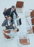 Employees sitting at the desk and looking up. Top view .employees sitting at the desk and looking up Royalty Free Stock Image