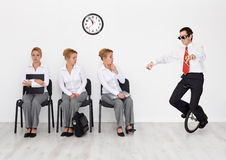Employees with special skills wanted. Concept - men with monocycle Stock Photos