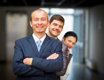 employees standing around their manager Stock Image