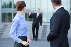 Employees talking in front of business centre Stock Photo
