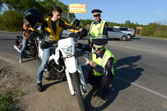 Employees of the traffic police service check of motorcyclists on the road. Stock Image
