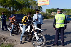 Employees of the traffic police service check of motorcyclists on the road. Royalty Free Stock Photography