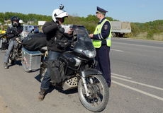 Employees of the traffic police service check of motorcyclists on the road. Stock Photo