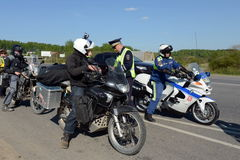 Employees of the traffic police service check of motorcyclists on the road. Royalty Free Stock Images