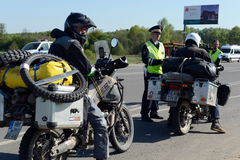 Employees of the traffic police service check of motorcyclists on the road. Royalty Free Stock Photos