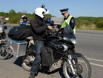 Employees of the traffic police service check of motorcyclists on the road. Stock Images