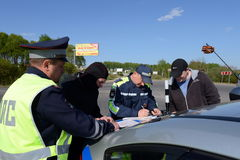 Employees of the traffic police service draws up a Protocol on violation of traffic rules. Royalty Free Stock Photos