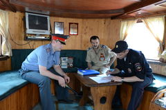 Employees of the transport police check the documents of the ship is the captain. Stock Image