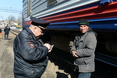 Employees of the transport police during a RAID on the railway in Moscow check the documents of citizens. Stock Photos