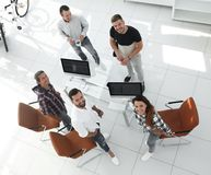 Employees of travel agencies standing in office. View the top employees of travel agencies standing in office and looking at camera Stock Photography