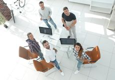 Employees of travel agencies standing in office. View the top employees of travel agencies standing in office and looking at camera Royalty Free Stock Photography