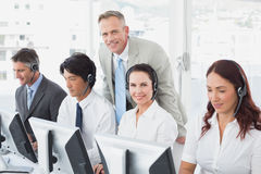 Employees typing on their computers Stock Photo