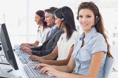 Employees typing on their computers Royalty Free Stock Images