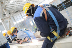 Employees welding crane rails Stock Images