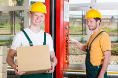 Employees working in big factory Royalty Free Stock Photos