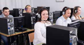 Employees working at office. Casual business team working at call center office. Selective focus stock photography