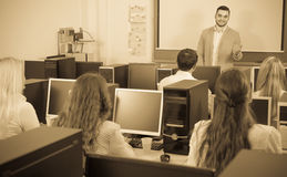 Employees working at office. Positive sales department manager and employees working at office on pc stock photo