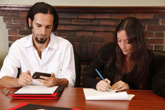 Employees working on project. Attractive man and woman work on project together in the office royalty free stock photo