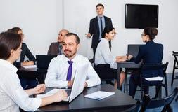 Employeesin office on business meeting Stock Image
