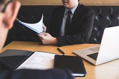 Employer arriving for a job interview, businessman listen to candidate answers explaining about his profile and colloquy dream job royalty free stock photography