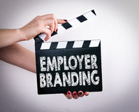 Employer Branding. Female hands holding movie clapper.  Stock Image