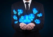 Employer. Businessman employer holding a symbol of employer Royalty Free Stock Photo