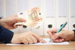 Employer or businessman showing where to sign  in exchange to gi Royalty Free Stock Photo