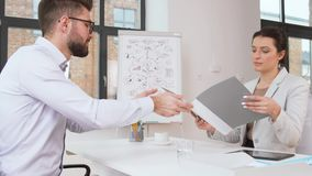 Employer having interview with employee at office. Job, business and employment concept - female employer or hr manager having interview with male employee at stock video footage