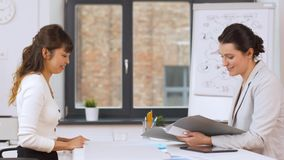 Employer having interview with employee at office stock footage