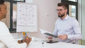 Employer having interview with employee at office stock video