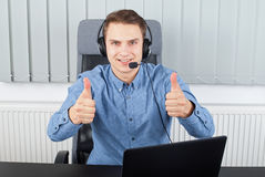 Employer having a skype conference. Picture of happy employer having a skype conference royalty free stock images