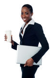 Employer holding laptop and beverage Stock Photography