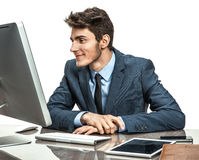 Employer looking at computer screen with pleasure Royalty Free Stock Photo