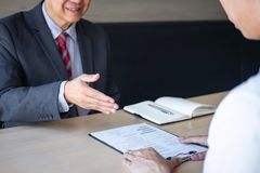 Employer or recruiter holding reading a resume during about colloquy his profile of candidate, employer in suit is conducting a royalty free stock images