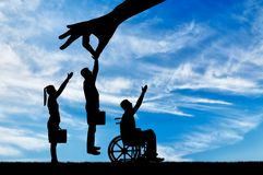 Concept of Discrimination and Inequality in the Employment of People with Disabilities. Employer`s hand chooses a healthy worker from a crowd of people and not royalty free stock image