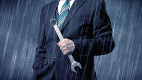 Employer standing with tool on his hand Stock Image