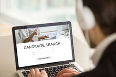 Employer using laptop searching candidates, find resumes online. Employer searching candidates for part or full time job on internet web service, headhunter Stock Photography