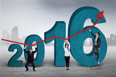 Employers lifting upward arrow with numbers 2016 Stock Image