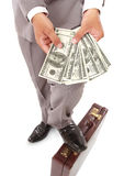 Employers showed a lot of money in his hands. Isolated on white background Royalty Free Stock Photo
