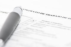 Employment?. Employment contract document with black pen, concept Stock Images