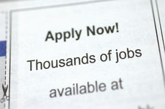 Employment ad on newspaper. Newspaper employment ad - Apply Now! Thousands of jobs available Stock Photography
