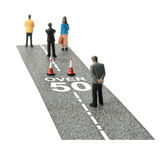 Employment ageism. Concept image depicting employment ageism and discrimination for people over fifty. Selective focus on the road text. Copy space Royalty Free Stock Photography