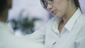 Employment agency, female manager in eyeglasses talking to trainee at office. Stock footage stock video footage