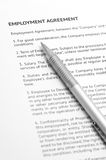 Employment agreement. Close-up of silver pen on employment agreement. Selective focus on top of pen Royalty Free Stock Photography
