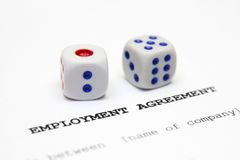 Employment agreement. Close up of dice on Employment agreement Royalty Free Stock Images