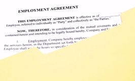 Employment Agreement in Document File. A standard employment agreement in a manila file folder Royalty Free Stock Photography