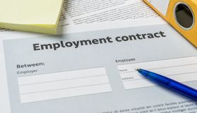 Employment agreement with a pen on a desk Royalty Free Stock Photography